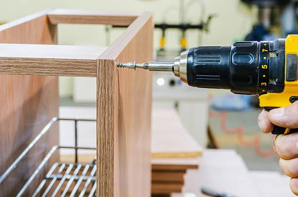 assembling of furniture power tools - telefonschrank stock-fotos und bilder