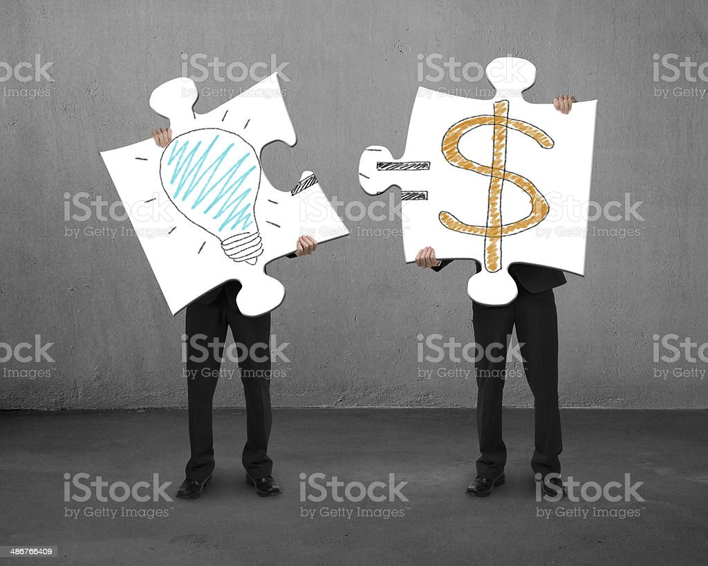 Assembling puzzles with bulb and money drawings stock photo