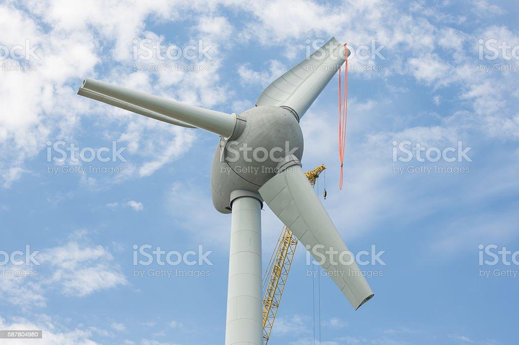 Assembling wings Dutch windturbine with large crane stock photo