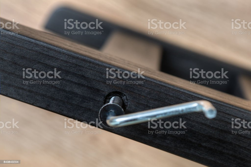 Screwed up furniture screw in wooden plank with allen key, build a...