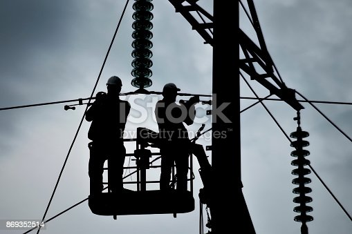 istock Assembly and installation of new support of a power line 869352514