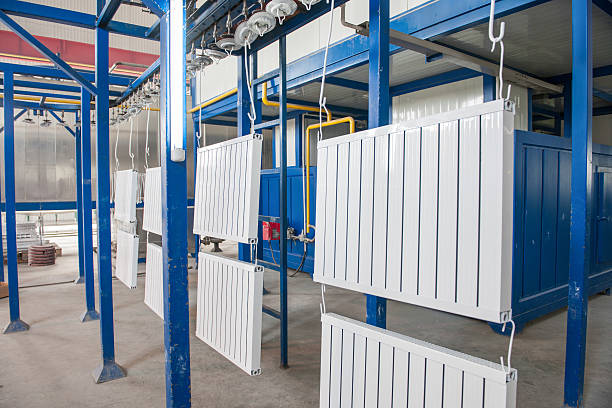 assembly and painting heating radiators in manufacturing – Foto
