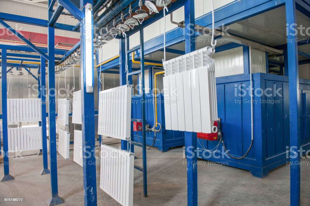 assembly and painting heating radiators in manufacturing stock photo