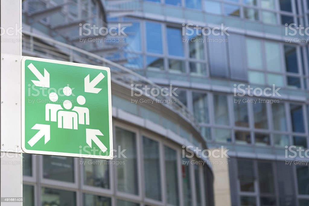 Assembly Area sign in front of business building stock photo