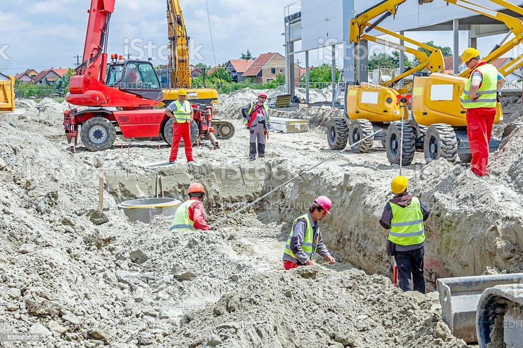 Assembly concrete drainage manhole on building site stock photo