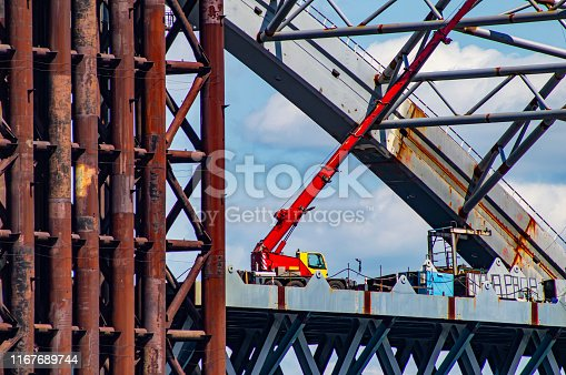Assembly cranes for the construction of the bridge. Construction equipment. Industrial background.