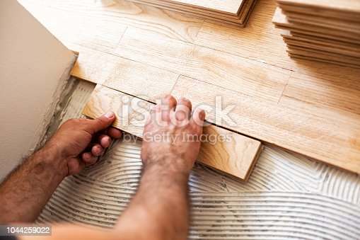 922081754istockphoto Assembly of patterned wood surface 1044259022
