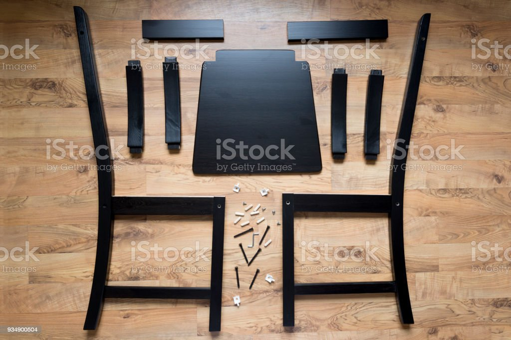 Assembly of wooden furniture, wooden parts of the dining chair stock photo