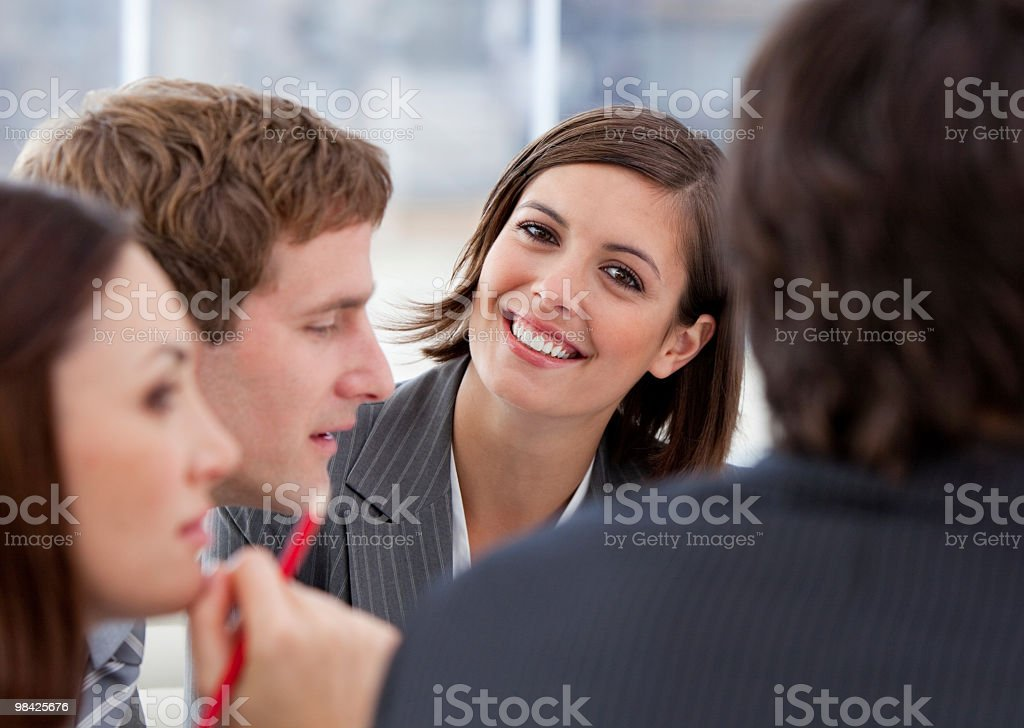Assertive businesswoman and her team in a meeting royalty-free stock photo