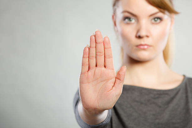 assertive woman making stop gesture. - attestation photos et images de collection