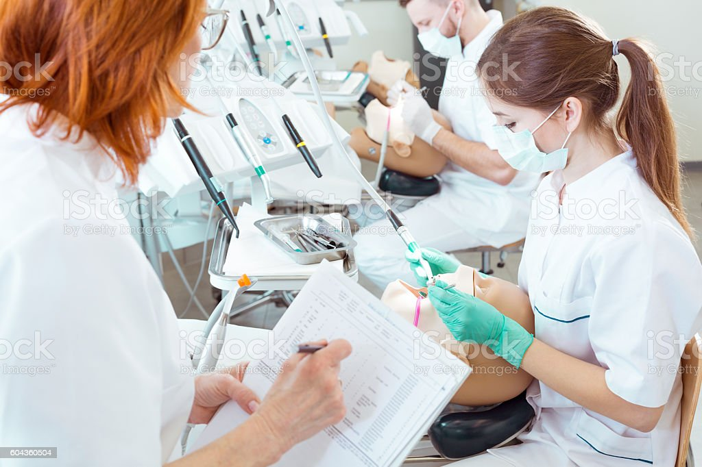Assesing their skills in cavity treatment stock photo