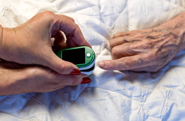 Assessment of the respiratory system function. measurement of blood saturation and pulse in an elderly patient using a pulse oximeter. health and medicine Assessment of the respiratory system function. measurement of blood saturation and pulse in an elderly patient using a pulse oximeter. health and medicine saturated color stock pictures, royalty-free photos & images