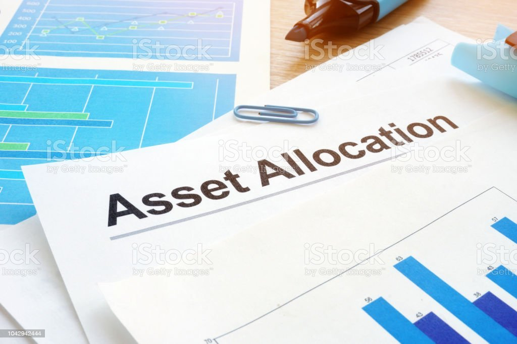 Asset allocation. Financial documents and pen on an office desk. stock photo