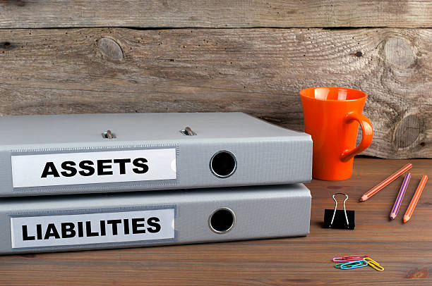 Assets and Liabilities - two folders on wooden office desk – Foto