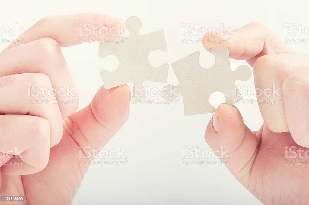 Assistance teamwork - puzzle connection royalty-free stock photo