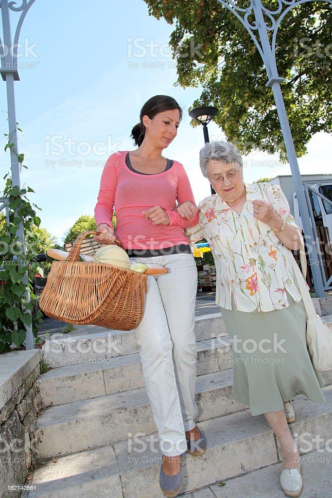 Assistance to eldeerly people stock photo