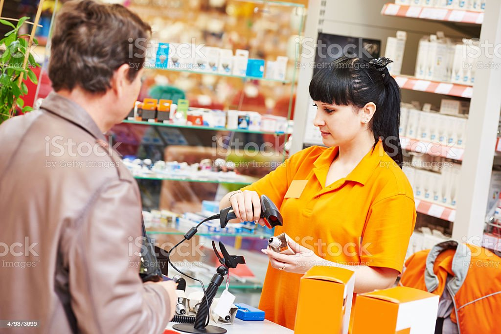 assistant cashier works with buyer shop stock photo