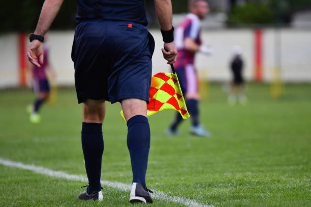 Assistant referee or Lineman of football or soccer holding flag Assistant referee or Lineman of football or soccer holding flag referee stock pictures, royalty-free photos & images