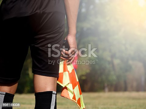 istock Assistant referee or Lineman of football or soccer holding flag 898149008