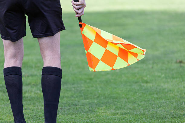 assistant referees in action during a soccer match - judge sports official stock photos and pictures