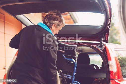 istock Assistant Son Putting Wheelchair to the Car, Europe 494793020