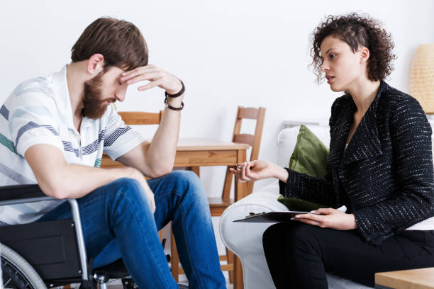 assistant talking with invalid patient - psychiatric ward stock photos and pictures