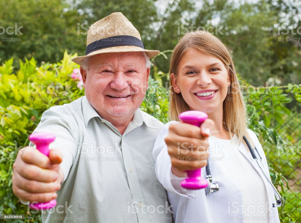 Assisted medical workout stock photo