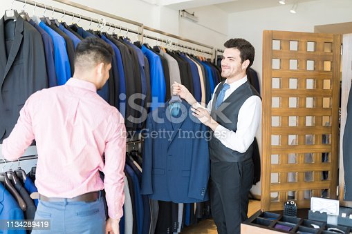 istock Assisting Customer In Buying Formals 1134289419