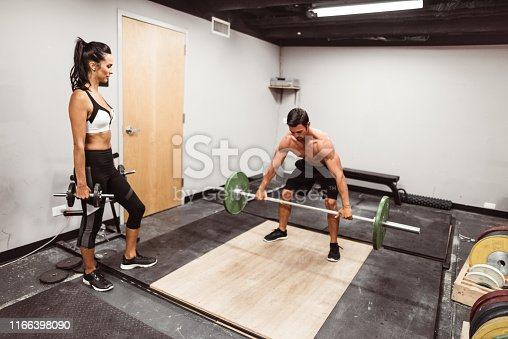 610237160 istock photo assisting the squatter 1166398090