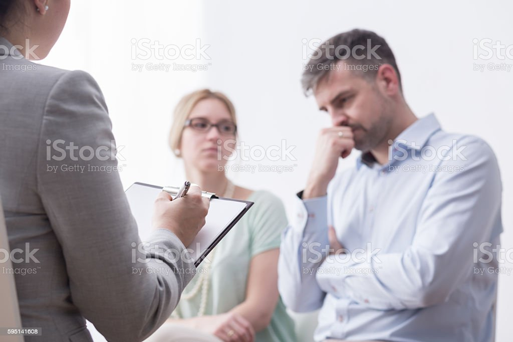 Assisting them with professional help stock photo