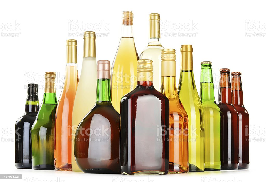 Assorted alcohol bottles against white background stock photo