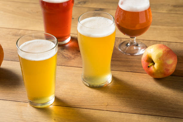Assorted Alcoholic Hard Cider Flight Assorted Alcoholic Hard Cider Flight in Pint Glasses hot apple cider stock pictures, royalty-free photos & images