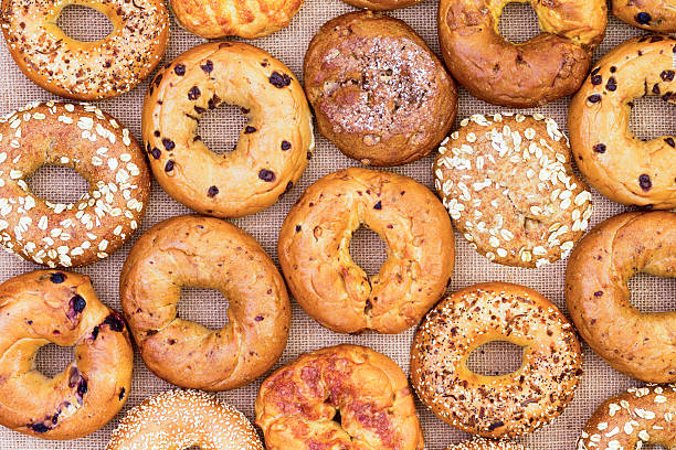 Assorted bagels in a full frame background - Photo