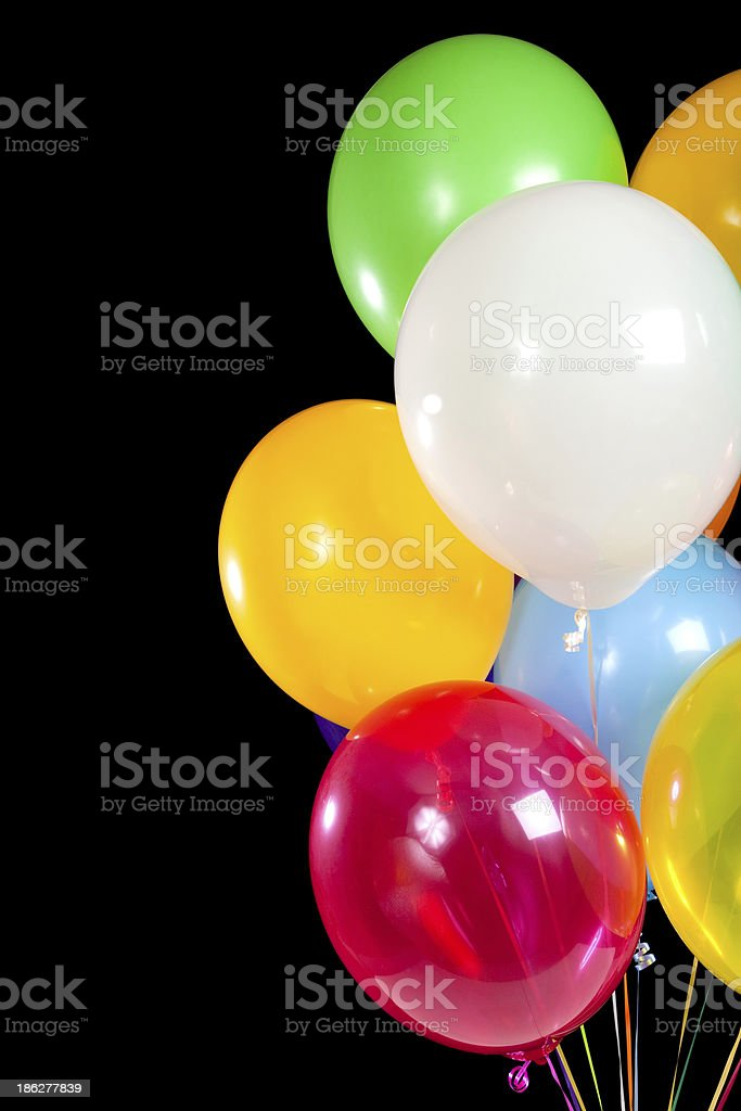 Assorted balloons on a black background royalty-free stock photo