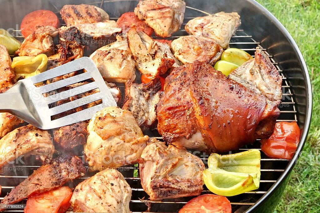 Assorted BBQ Roasted  Pork And Chicken Meat With Vegetables stock photo