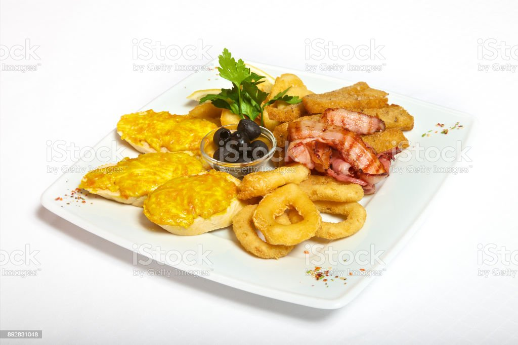 Assorted beer snacks on plate stock photo
