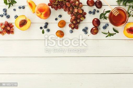 863562090 istock photo Assorted berries and fruits on white wooden table top view 961837218