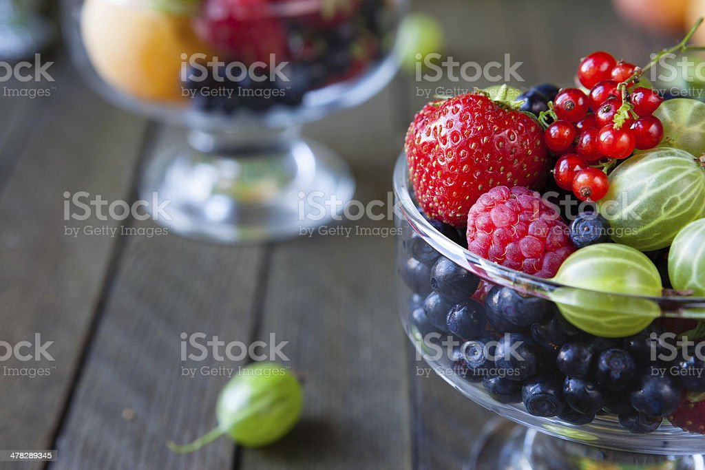 Assorted berries in a transparent bowl royalty-free stock photo