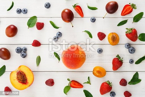 862604802 istock photo Assorted berries on white wooden table top view 859662538