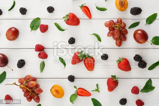 862604802 istock photo Assorted berries on white wooden table top view 863563900