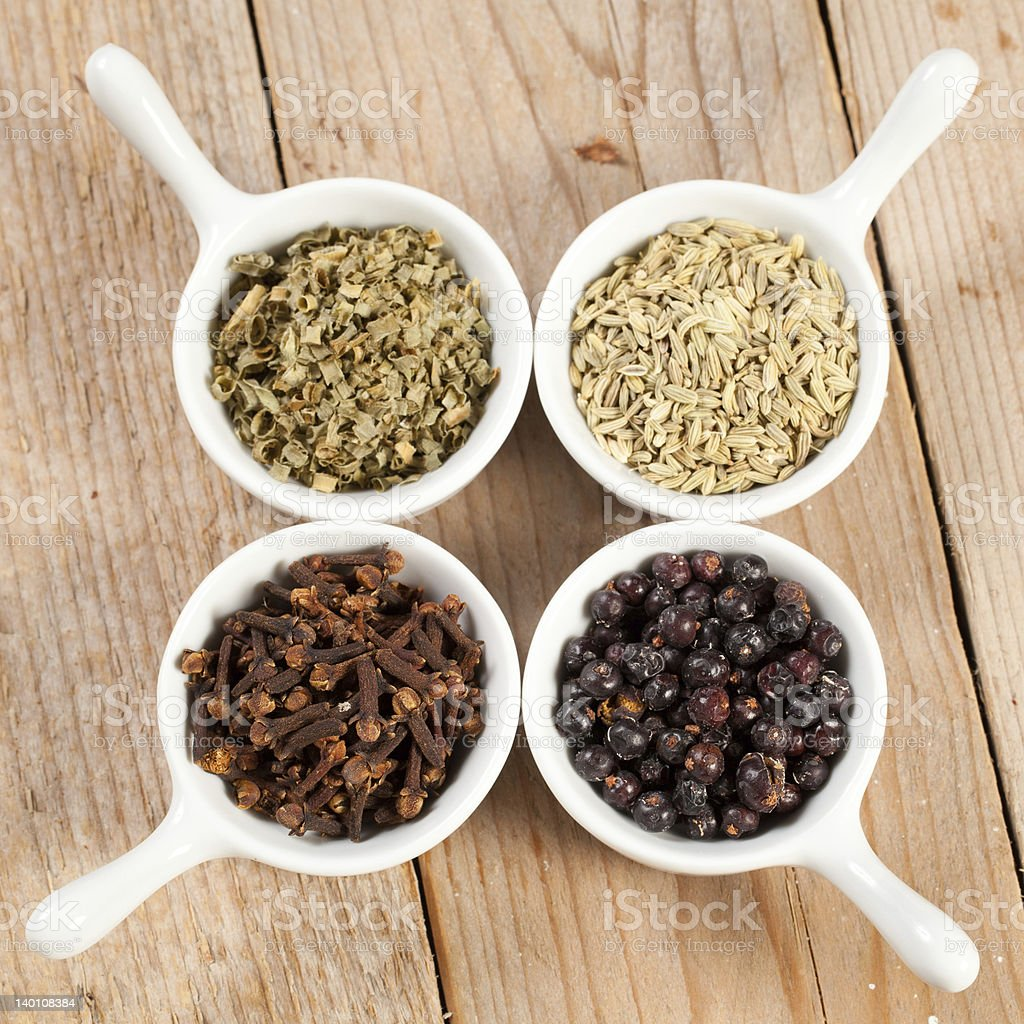 Assorted bowls of spices over wooden table royalty-free stock photo