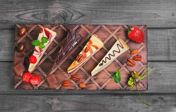 assorted cakes cheesecake - obst käsekuchen stock-fotos und bilder