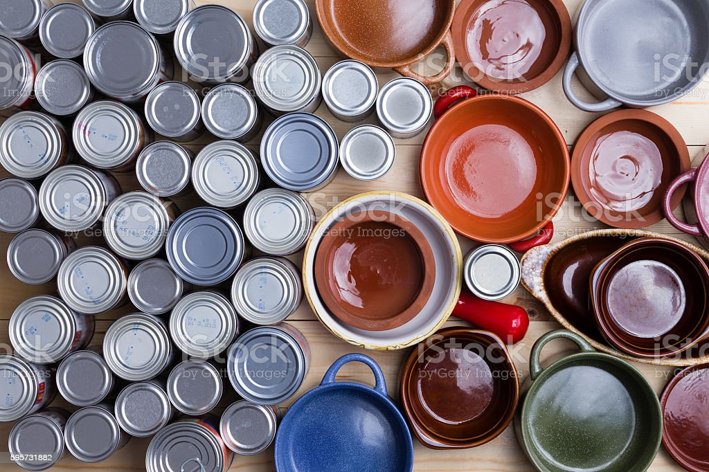 Assorted canned food and empty bowls stock photo