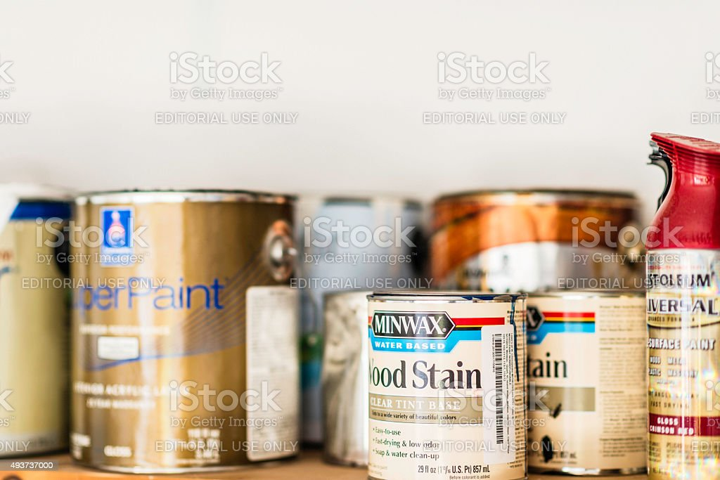 assorted cans of paint spray paint and wood stain royaltyfree stock photo
