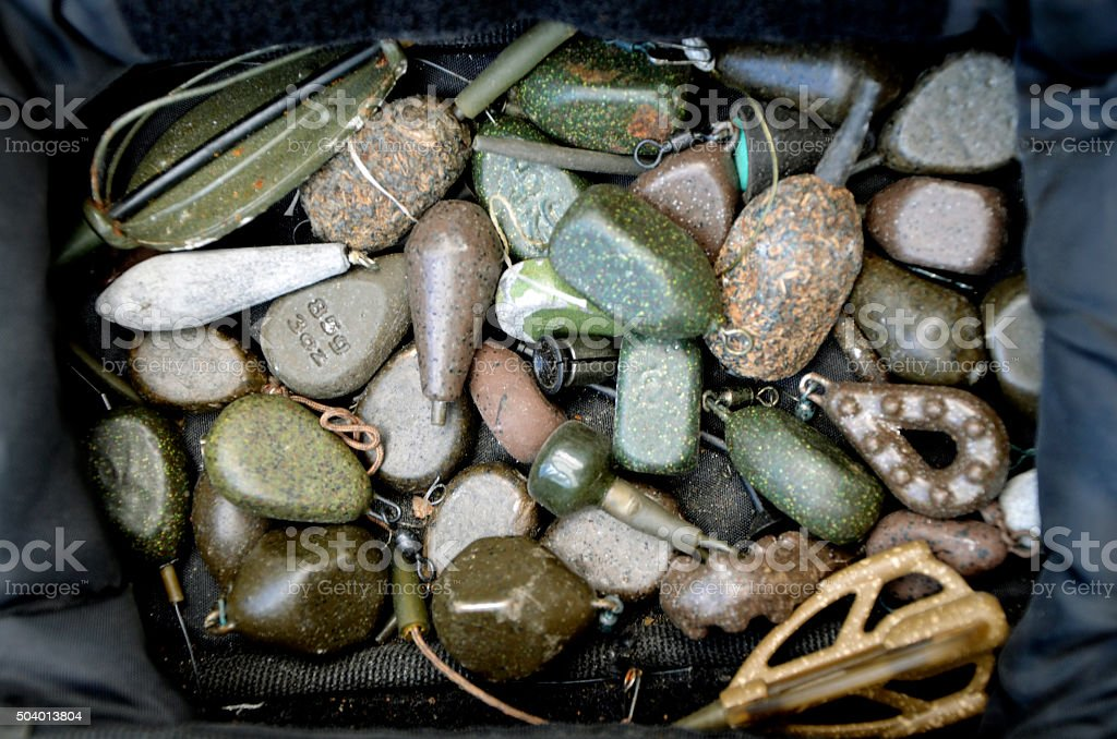 Assorted Carp Fishing Tackle Lead Weights in Bag stock photo