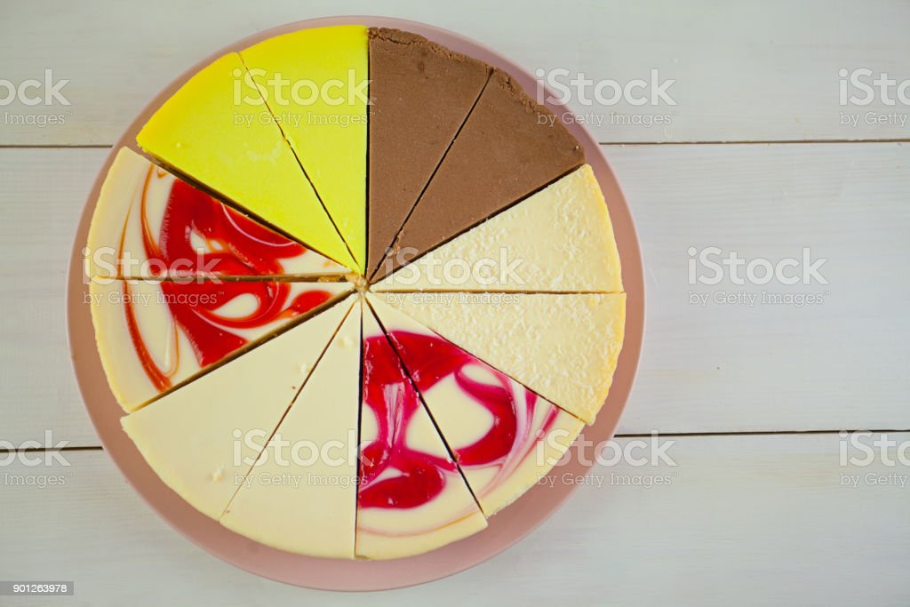 assorted cheesecake on plate on white table stock photo