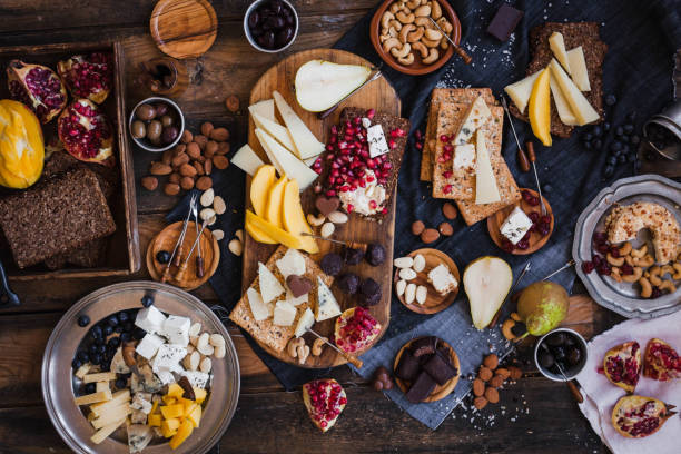 Assorted cheeses fruits nuts platter stock photo