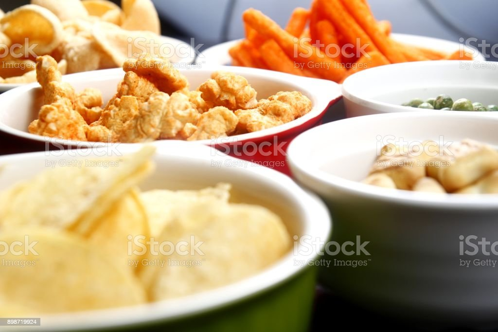 Assorted chips and junk food stock photo