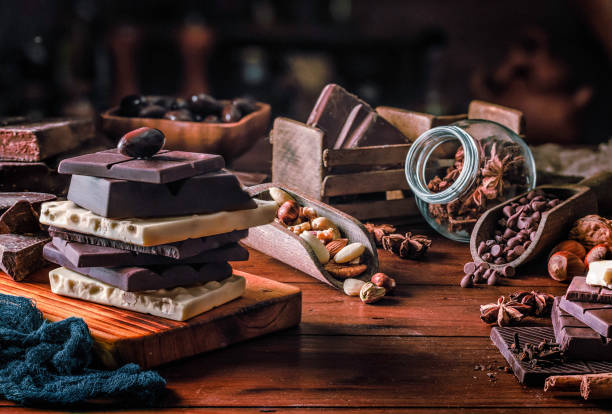 Assorted chocolate, nuts and dried fruit in old fashioned style stock photo