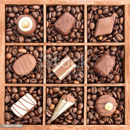 istock Assorted chocolates in wooden box with coffee beans 1094411900